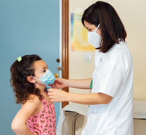 Doctor with child providing pediatric services